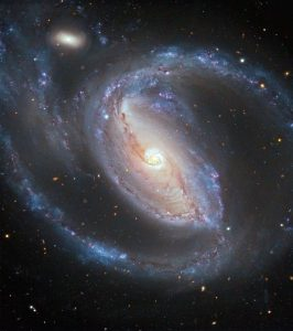 Arp-77-NGC-1097-a-barred-Seyfert-spiral-galaxy-and-NGC-1097A-the-small-elliptical-companion-about-50-million-light-years-away-in-Fornax-have-been-interacting-in-the-recent-past